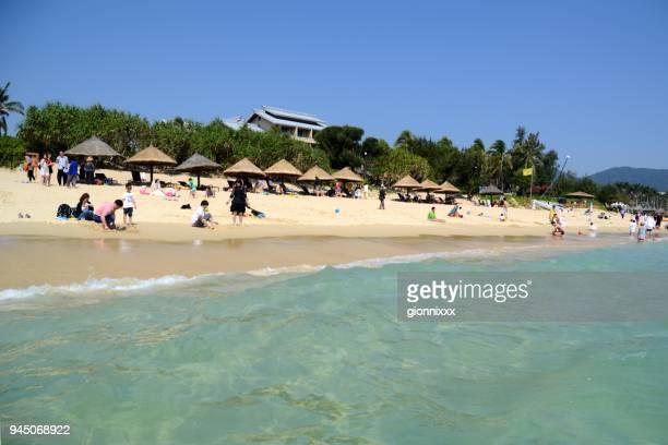 Tourists relaxing at Yalong Bay, Sanya, Hainan, China
