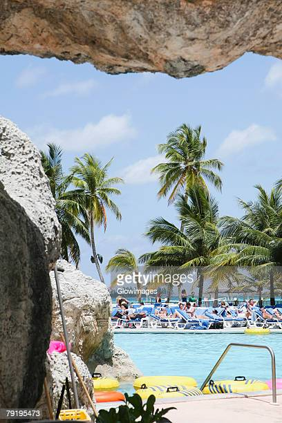 tourists relaxing in a tourist resort, cable beach, nassau, bahamas - cable beach bahamas stock photos and pictures