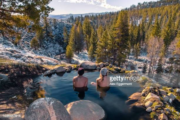 tourists relaxing in hot spring near bridgeport, california, usa - hot spring stock pictures, royalty-free photos & images