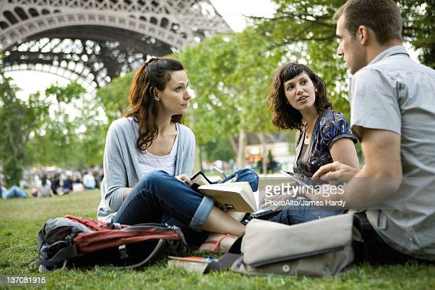 Tourists relaxing near Eiffel Tower, Paris, France