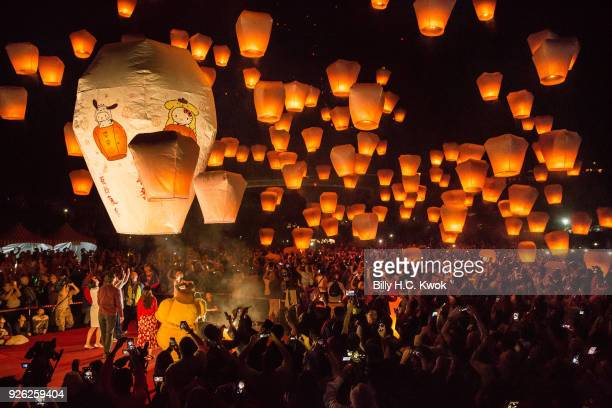 Tourists release sky lantern during the Pingxi lantern festival on March 2 2018 in Pingxi Taiwan Pingxi a Taiwanese district known for its old train...
