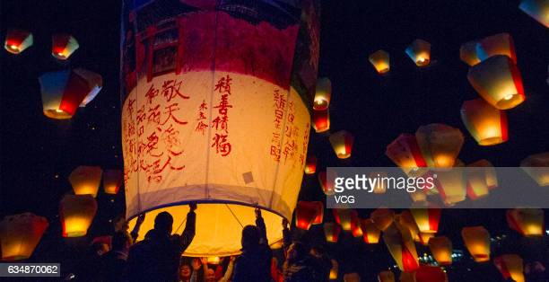 Tourists release sky lanterns during the Pingxi Sky Lantern Festival on February 11 2017 in New Taipei City Taiwan of China Tourists lit and released...