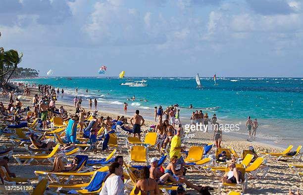 Tourists rest at Bavaro beach in Punta Cana Dominican Republic on January 16 2012 Tourism is the main industry in Dominican Republic and Punta Cana...