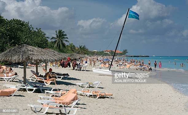 Tourists rest at the beach in Varadero 130 km east of Havana on April 6 2008 The lifting by Cuban President Raul Castro of the prohibition to Cubans...