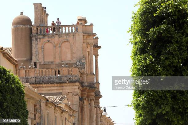 Tourists rest on the church of St Charles Borromeo terrace on June 05 2018 in Sicily Italy Noto is a city and comune in the Province of Syracuse in...