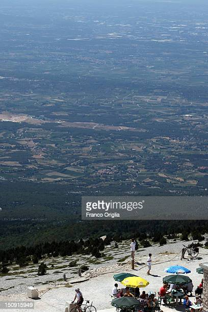 Tourists rest on the summit of Mont Ventoux on August 17 2012 in Mont Ventoux Carpentras France Mont Ventoux is a mountain in the Provence region of...