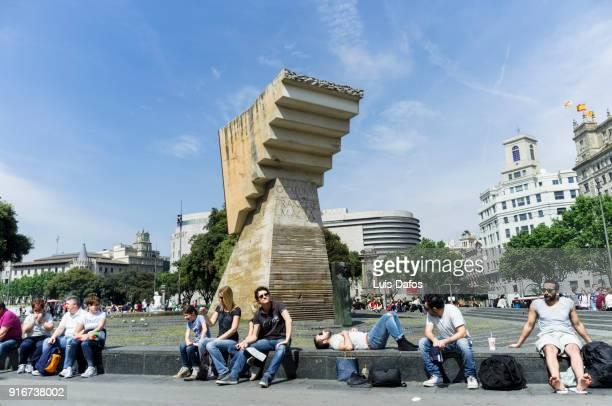 Tourists resting in Plaça de Catalunya