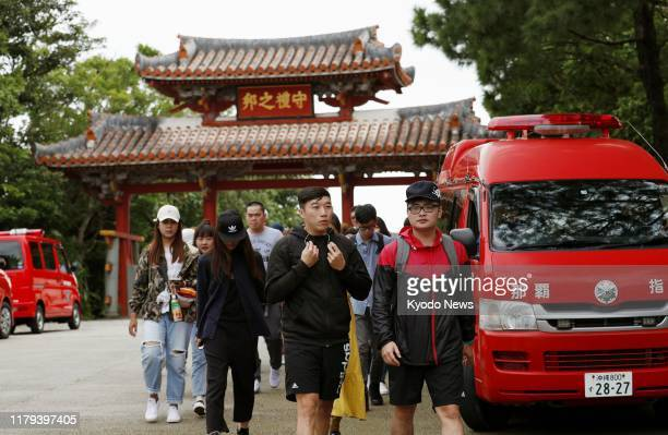 Tourists return as Shuri Castle is closed in Naha Okinawa Prefecture southern Japan on Nov 1 after a predawn fire the previous day engulfed the...