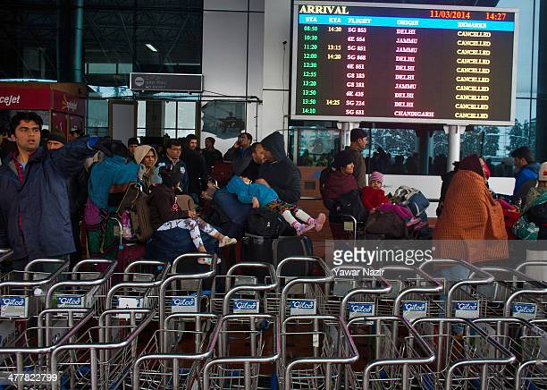 Tourists return to their hotels from the airport after all the flights were cancelled by the authorities following a heavy snowfall on March 11 in...