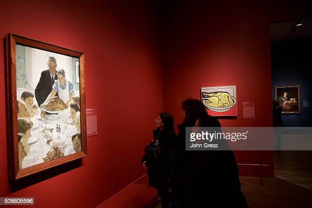 """Tourists review Norman Rockwell's Freedom from Want which is part of the """"Art and Appetite exhibition at the Art Institute of Chicago on December 19,..."""