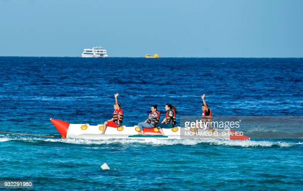 Tourists ride a banana boat in Egypt's Red Sea resort of Hurghada on February 18 2018 Egypt is seeing a promising rebound in tourism following...