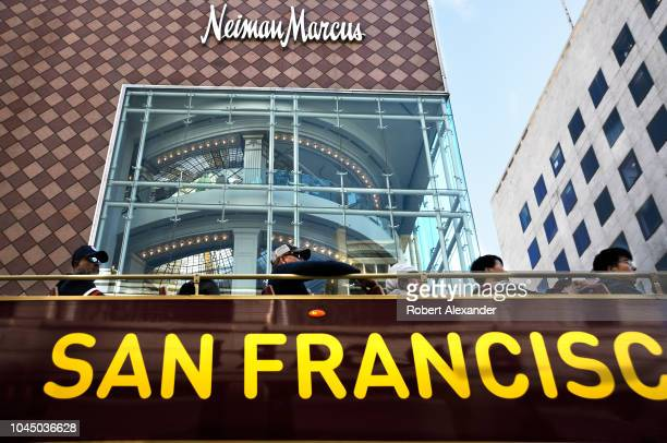 SAN FRANCISCO CALIFORNIA SEPTEMBER 13 2018 Tourists ride a sightseeing bus past a Neiman Marcus store in San Francisco California