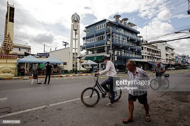 Tourists ride bicycles past the site of an explosion on Friday August 12 2016 in Hua Hin Thailand A series of coordinated blasts across Southern...