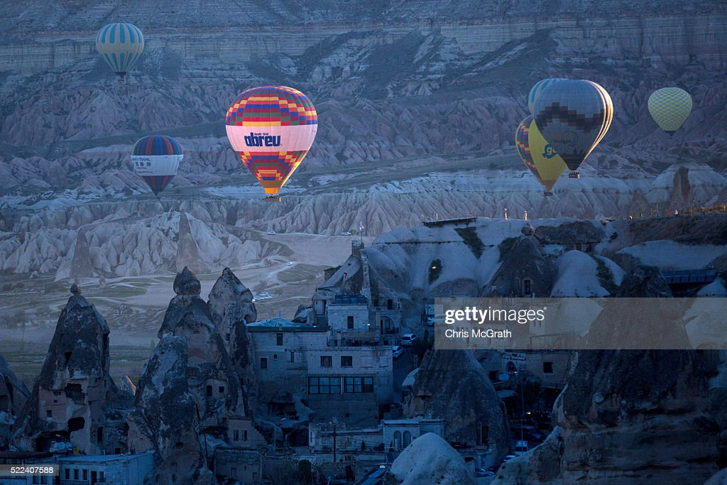 Tourists ride hot air balloons near the town of Goreme on April 17, 2016 in Nevsehir, Turkey. Cappadocia, a historical region in Central Anatolia dating back to 3000 B.C is one of the most famous tourist sites in Turkey. Listed as a World Heritage Site in 1985, and known for its unique volcanic landscape, fairy chimneys, large network of underground dwellings and some of the best hot air ballooning in the world, Cappadocia is preparing for peak tourist season to begin in the first week of May. Despite Turkey's tourism downturn, due to the recent terrorist attacks, internal instability and tension with Russia, local vendors expect tourist numbers to be stable mainly due to the unique activities on offer and unlike other tourist areas in Turkey such as Antalya, which is popular with Russian tourists, Cappadocia caters to the huge Asian tourist market.
