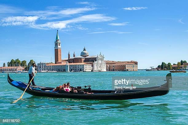 Tourists ride on gondolas in Venice Italy