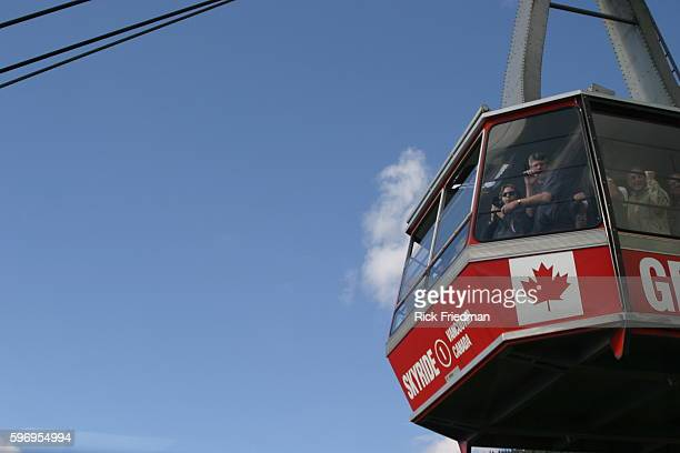 Tourists ride on the Grouse Mountain Sky ride to get to Grouse Mountain
