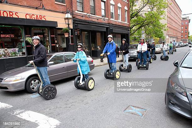 Tourists ride Segway PT Personal Transporter, North End, Boston, MA.