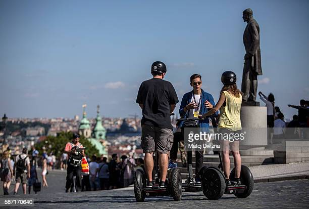 Tourists ride Segways on a street in the city centre in front of the Prague Castle on August 7 2016 in Prague Czech Republic Prague city authorities...
