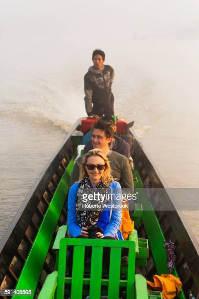 Tourists riding in canoe on rural lake