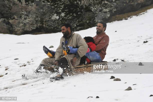 Tourists riding on the sledge at famous tourist destination Sonamarg on November 15 2017 some 80 kms from Srinagar India The twin health resorts of...