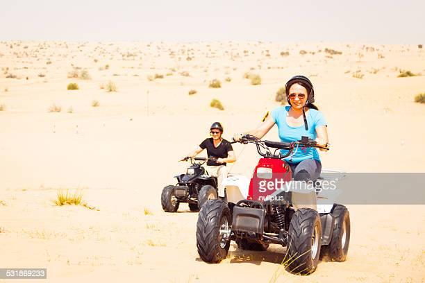 tourists riding quad bikes