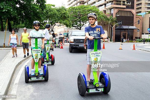 tourists riding segway - segway stock pictures, royalty-free photos & images