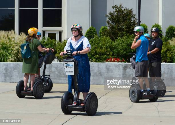 Tourists riding Segway PT personal transporters prepare to depart from a stop on a guided Segway tour in downtown Nashville, Tennessee.