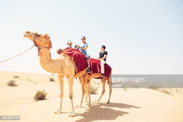 tourists riding through the desert