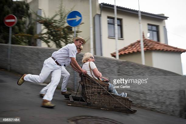 tourists riding toboggan in madeira - funchal stock pictures, royalty-free photos & images