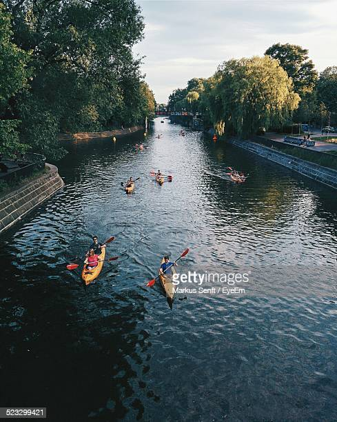 tourists rowing boats in a canal - kanal stock-fotos und bilder