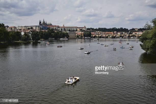 Tourists sail in pleasure boats near the Charles Bridge on the Vltava river in Prague Czech Republic on Monday July 22 2019 Prague was Europe's fifth...