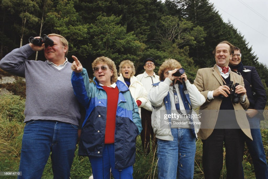 Tourists searching for the fabled Loch Ness Monster by Loch Ness in the Scottish Highlands, 1993.
