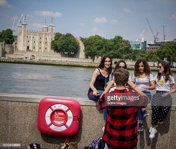 Tourists seen taking pictures during a warm day Another heat wave is scheduled to hit parts of the UK this weekend