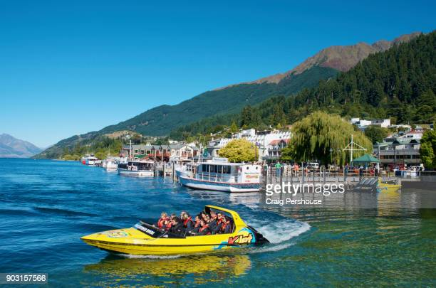 Tourists setting off for a jet boat ride in Queenstown Bay.