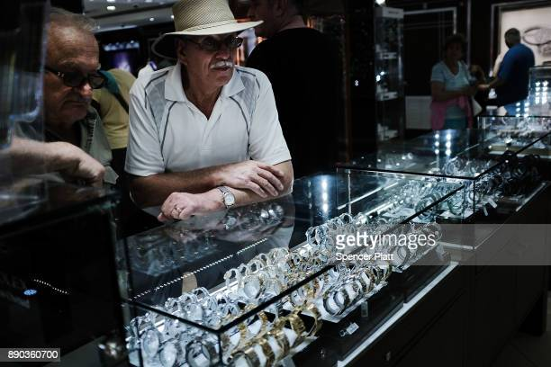 Tourists shop at a store after arriving from a cruise ship in St John's on December 11 2017 in St John's Antigua While its sister island of Barbuda...
