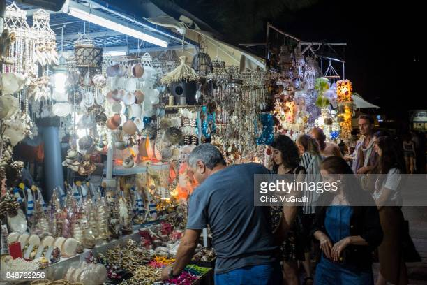 Tourists shop at a street market on September 15 2017 in Bodrum Turkey Bodrum and the Bodrum Peninsula famous for being a celebrity and luxury...