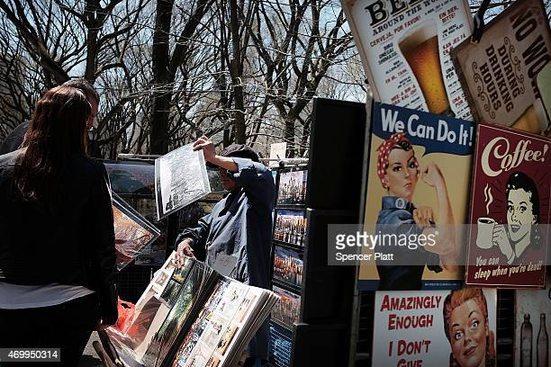 Tourists shop for pictures in Manhattan's Central Park on a warm and sunny spring afternoon on April 16 2015 in New York City Following one of the...