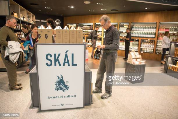 Tourists shopping at duty free stores while waiting for departing flights at Keflavik International Airport, Iceland