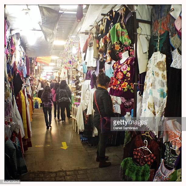 Tourists shopping at the indoor arts and crafts market in Coyoacan Mexico City Mexico