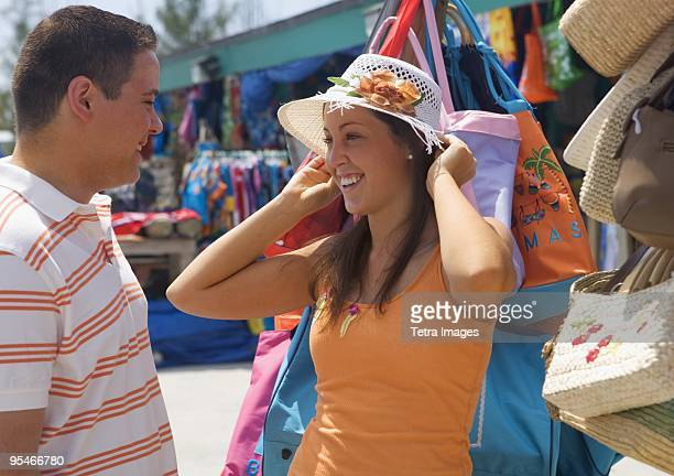 Tourists shopping for hat