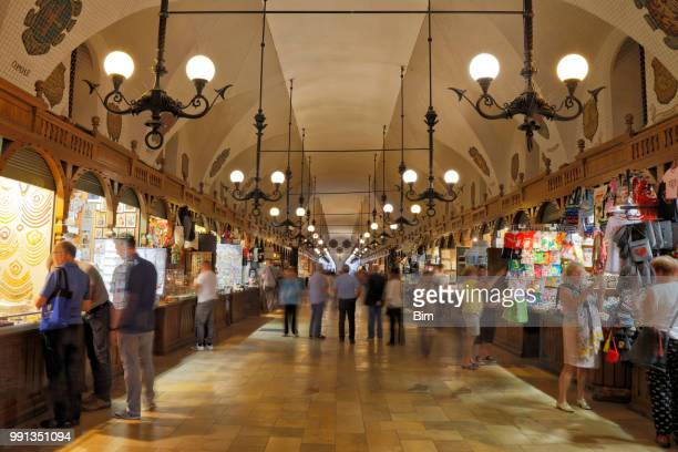 tourists shopping in cloth hall (sukiennice), cracow, poland - polish culture stock photos and pictures