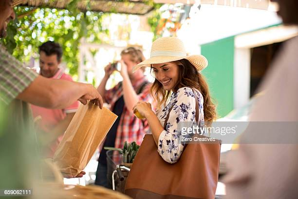 tourists shopping in market - happy merchant stock pictures, royalty-free photos & images