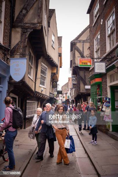 tourists shopping on the shambles in york, uk - york yorkshire stock pictures, royalty-free photos & images