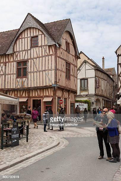 CONTENT] Tourists showing a map asking for the way in the streets of Provins medieval town in Seine et Marne France