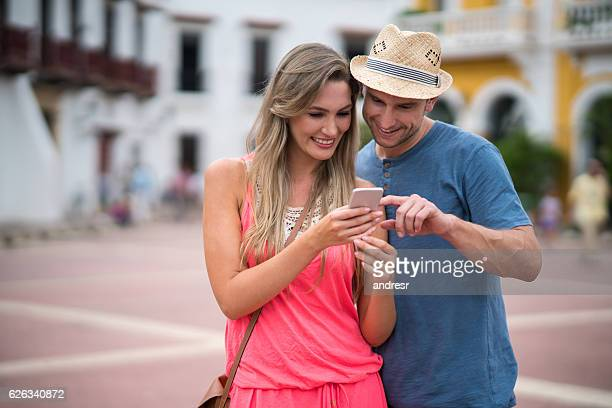 Tourists sightseeing using app on their cell phone