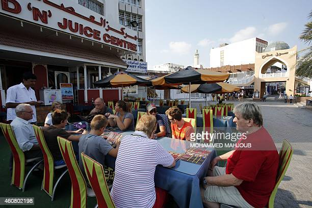 NEREIM Tourists sit at a restaurant on December 19 2014 in the Omani capital Muscat From desert camping to luxury hotels turtlewatching and even the...