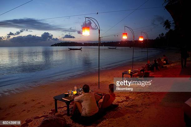 Tourists sit on the beach at a restaurant of Koh Phangan Surat Thani Thailand on Wednesday Jan 18 2017 Tourist arrivals are forecast at 341 million...