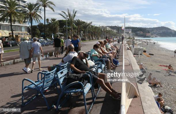 Tourists sit on the 'Promenade des Anglais' in Nice France 14 September 2016 Photo Ina Fassbender/dpa | usage worldwide