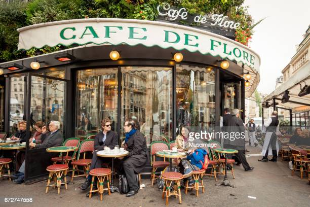 Tourists sit outside the café and enjoy street views
