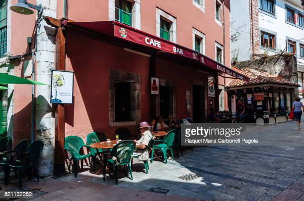Tourists sitting at a bar cafe terrace